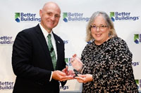 Energy Manager Tina Miller accepts the Goal Achiever Award on behalf of the Cambridge Housing Authority.