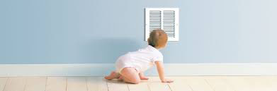 Baby crawling in front of an air return duct