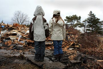 Two People Looking at a Disaster