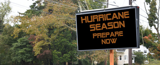 Emergency sign on the side of the road that reads: Hurricane Season: Prepare Now
