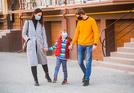 Family wearing masks