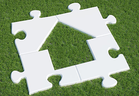 Puzzle pieces in the shape of a house