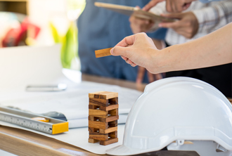 Desk with building blocks and hardhat