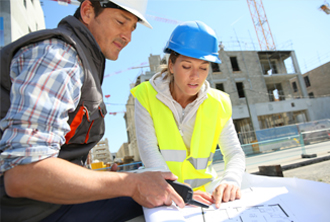 Man and woman on construction site