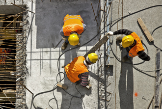 Aerial view of three construction workers